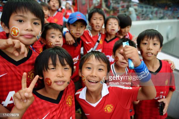 Manchester United fans pose prior to the preseason friendly match between Yokohama FMarinos and Manchester United at Nissan Stadium on July 23 2013...