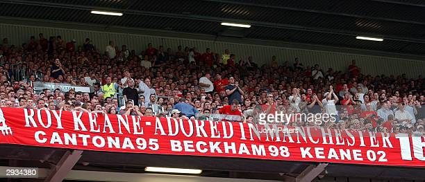 Manchester United fans unfurl a banner in support of Roy Keane after he was critised over his autobiography during the match between Manchester...