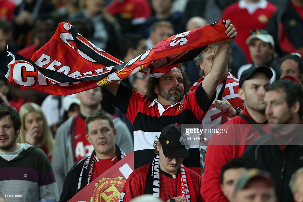 Manchester United fans watch from the stand during a first team training session as part of their pre-season tour of Bangkok, Australia, China, Japan and Hong Kong on July 19, 2013 in Sydney, Australia.