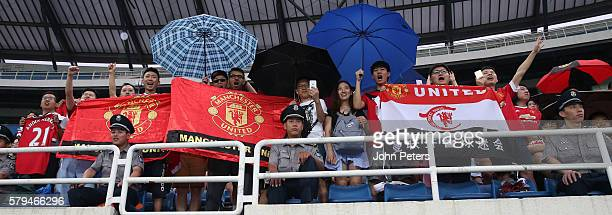 Manchester United fans watch from the stand during a first team training session as part of their preseason tour of China at Olympic Sports Centre...