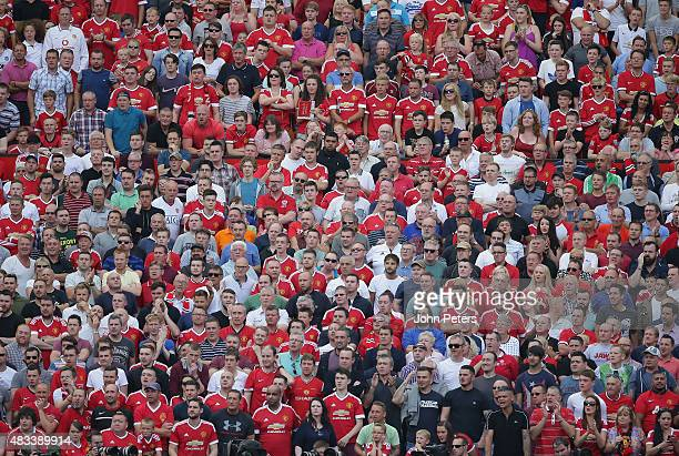 Manchester United fans watch from the stand during the Barclays Premier League match between Manchester United and Tottenham Hotspur at Old Trafford...
