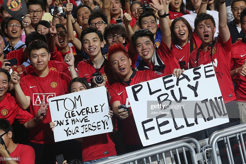 Manchester United fans watch from the stand during the pre-season friendly match between Kitchee FC and Manchester United as part of their pre-season tour of Bangkok, Australia, Japan and Hong Kong at Hong Kong Stadium on July 29, 2013 in So Kon Po, Hong Kong.