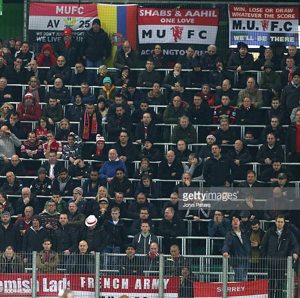 Manchester United fans watch from the stand during the UEFA Champions League match between VfL Wolfsburg and Manchester United at Volkswagen Arena on...