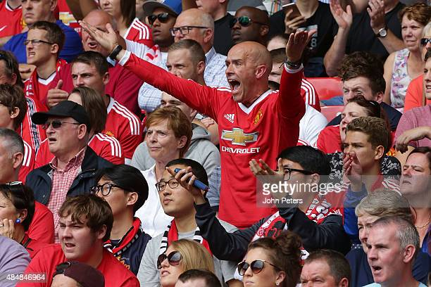 Manchester United fans watch from the stand the Barclays Premier League match between Manchester United and Newcastle United at Old Trafford on...