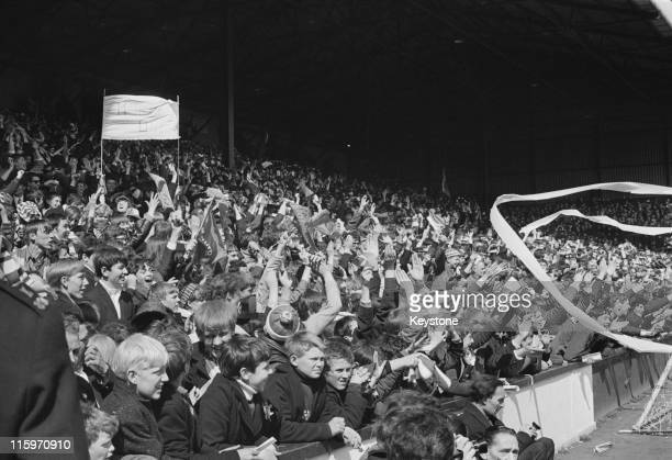 Manchester United fans watch their team beat West Ham 61 at Upton Park to become the League champions London 6th May 1967
