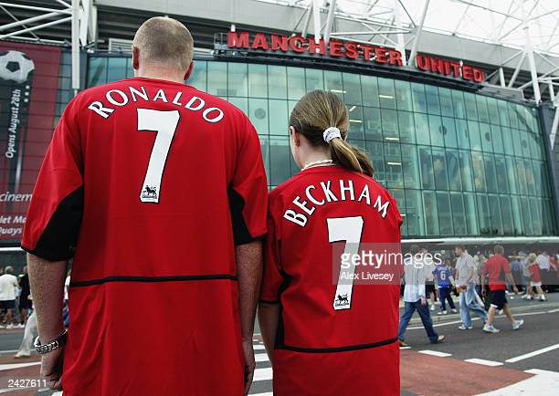 Manchester United fans wearing new boy Cristiano Ronaldo and recently departed David Beckham shirts during the FA Barclaycard Premiership match...