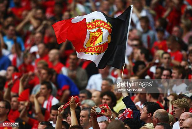 Manchester United fans welcome their team prior to the FA Community Shield match between Manchester United and Portsmouth at Wembley Stadium on...