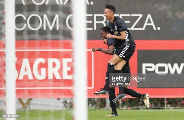 Manchester United FC forward Joshua Bohui celebrates with teammate Manchester United FC forward Millen Baars after scoring a goal during the UEFA...