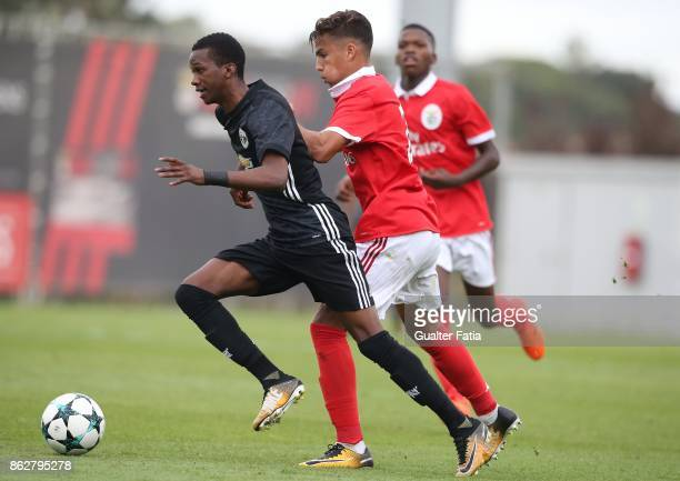 Manchester United FC forward Joshua Bohui with SL Benfica goalkeeper Celton Biai in action during the UEFA Youth League match between SL Benfica and...
