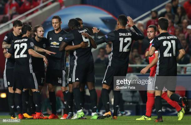 Manchester United FC forward Marcus Rashford from England celebrates with teammates after scoring a goal during the UEFA Champions League match...