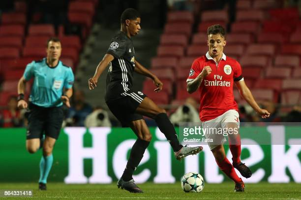 Manchester United FC forward Marcus Rashford from England with SL Benfica defender Alejandro Grimaldo from Spain in action during the UEFA Champions...