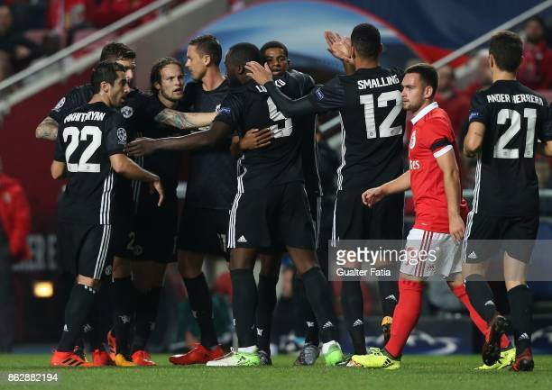 Manchester United FC forward Marcus Rashford of England celebrates with team mates after scoring a goal during the UEFA Champions League match...