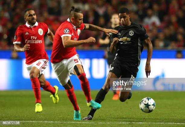Manchester United FC forward Marcus Rashford with SL Benfica midfielder Ljubomir Fejsa in action during the UEFA Champions League match between SL...