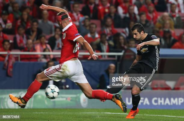 Manchester United FC midfielder Henrikh Mkhitaryan from Armenia with SL Benfica defender Ruben Dias from Portugal in action during the UEFA Champions...