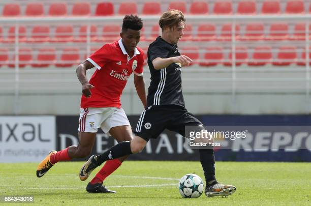 Manchester United FC midfielder Indy Boonen with SL Benfica midfielder Gedson Fernandes in action during the UEFA Youth League match between SL...