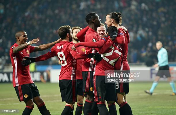 Manchester United FC players celebrate after scoring a goal during the UEFA Europa League football match between FC Zorya Luhansk and Manchester...