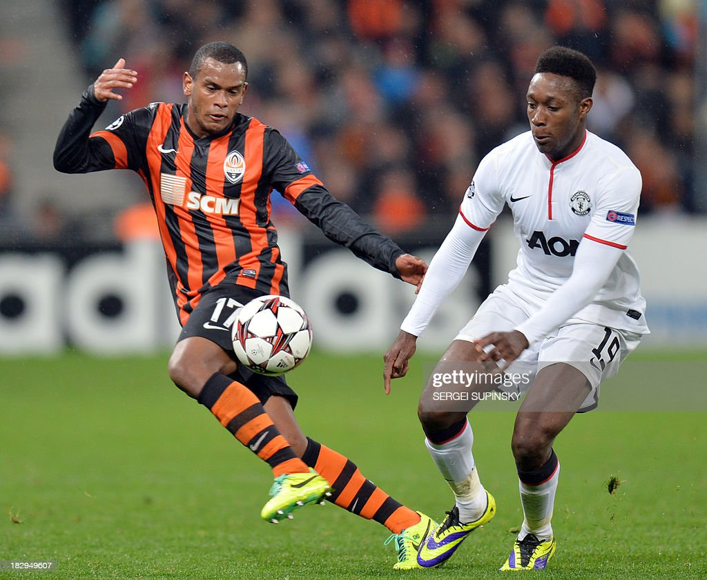 Manchester United FC's Danny Welbeck (R) vies with FC Shakhtar's Fernando during the European Champions League football match FC Shakhtar vs Manchester United in Donetsk on October 2, 2013.