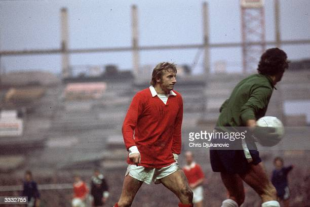 Manchester United Football Club player Denis Law during a match against Chelsea Football Club