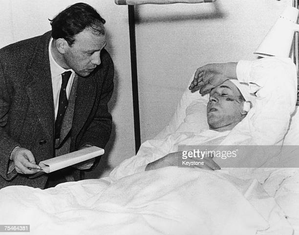 Manchester United footballer Bobby Charlton talking to a journalist while recovering in hospital in Munich after the plane crash which killed 23...