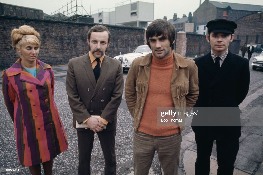 Manchester United footballer <a gi-track='captionPersonalityLinkClicked' href=/galleries/search?phrase=George+Best&family=editorial&specificpeople=206235 ng-click='$event.stopPropagation()'>George Best</a> (1946 - 2005) with his staff in Manchester, circa 1968. Left to right: Pearl Goodman (secretary), Malcolm Mooney (business manager), Best and Bill White (driver). In the background is Best's Jaguar saloon.