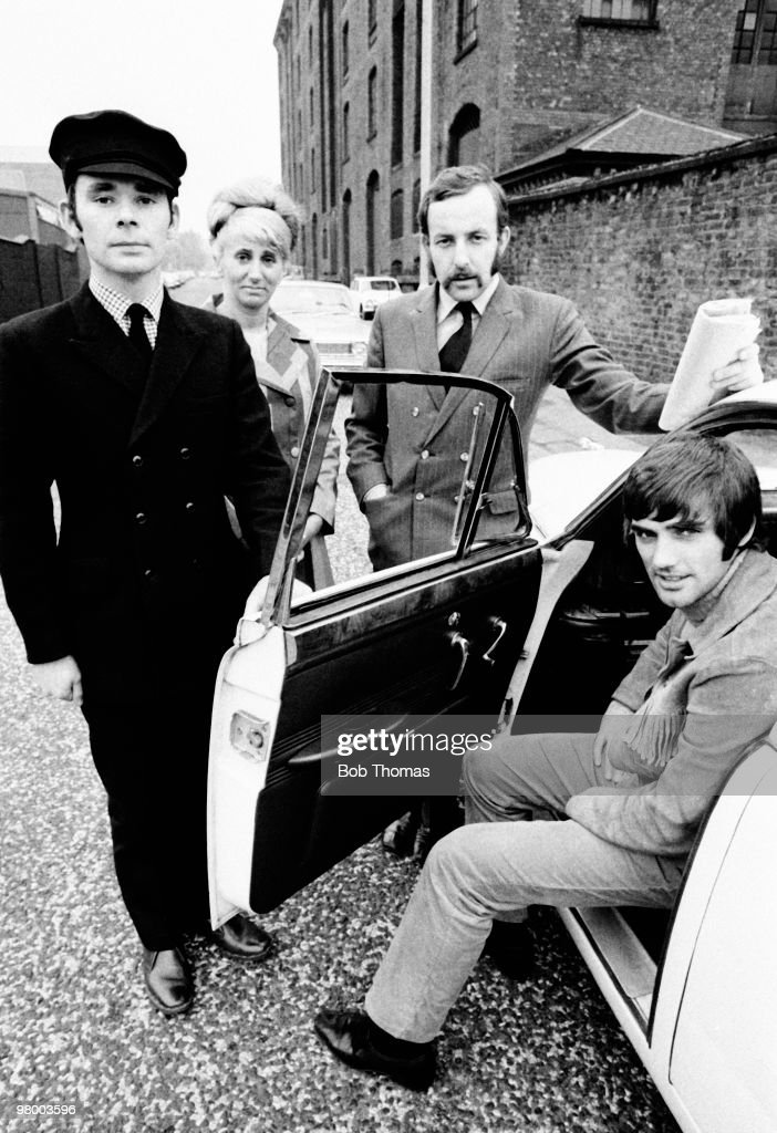 Manchester United footballer <a gi-track='captionPersonalityLinkClicked' href=/galleries/search?phrase=George+Best&family=editorial&specificpeople=206235 ng-click='$event.stopPropagation()'>George Best</a> with his staff, in Manchester, circa 1968. Left-right: Bill White (driver), Pearl Goodman (secretary), Malcolm Mooney (business manager) and <a gi-track='captionPersonalityLinkClicked' href=/galleries/search?phrase=George+Best&family=editorial&specificpeople=206235 ng-click='$event.stopPropagation()'>George Best</a> who is sitting in his Jaguar.