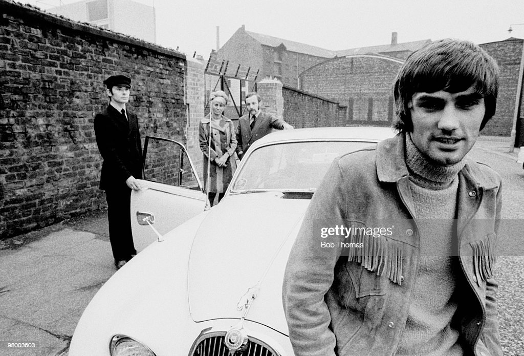 Manchester United footballer <a gi-track='captionPersonalityLinkClicked' href=/galleries/search?phrase=George+Best&family=editorial&specificpeople=206235 ng-click='$event.stopPropagation()'>George Best</a> with his staff, in Manchester, circa 1968. Left-right: Bill White (driver), Pearl Goodman (secretary), Malcolm Mooney (business manager) and <a gi-track='captionPersonalityLinkClicked' href=/galleries/search?phrase=George+Best&family=editorial&specificpeople=206235 ng-click='$event.stopPropagation()'>George Best</a> who is sitting on the bonnet of his Jaguar.