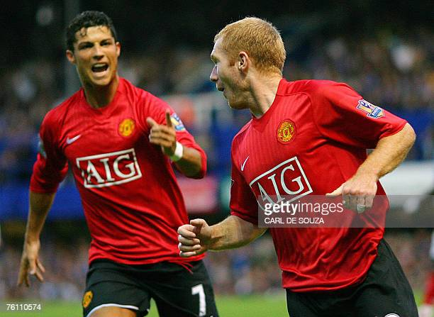 Manchester United footballer Paul Scholes celebrates his goal with teammate Cristiano Ronaldo as they play against Portsmouth at Fratton Park in...