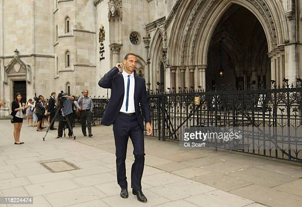 Manchester United footballer Rio Ferdinand leaves the High Court on July 5 2011 in London England Mr Ferdinand is seeking damages following an...