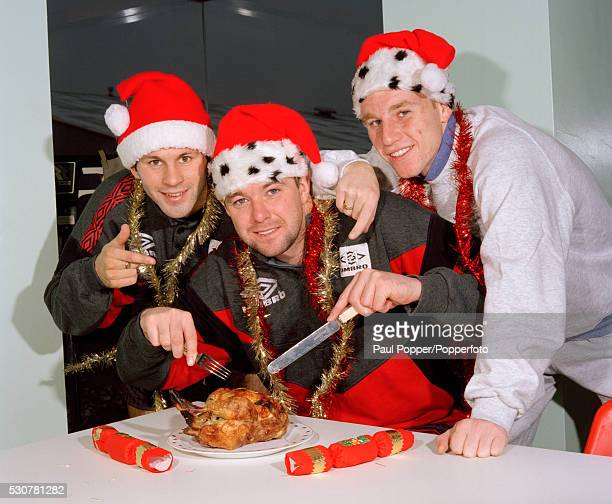 Manchester United footballers Ryan Giggs Gary Pallister and Nicky Butt getting into the Christmas spirit after training in Manchester circa December...