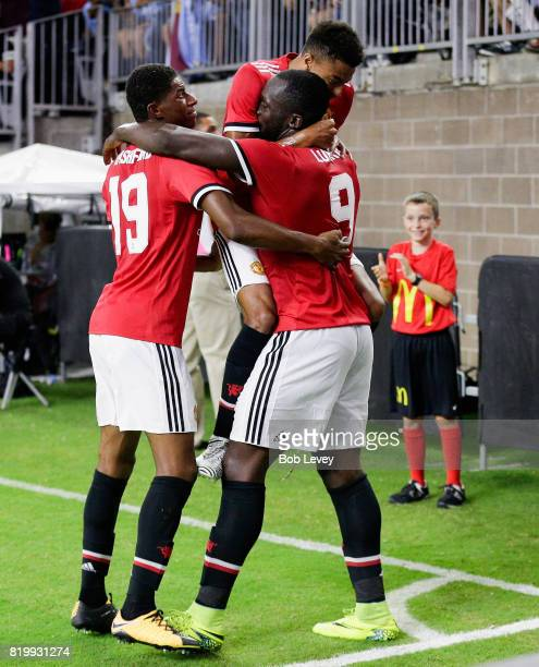Manchester United forward Romelu Lukaku celebrates with forward Marcus Rashford and midfielder Jesse Lingard after scoring against Manchester City at...