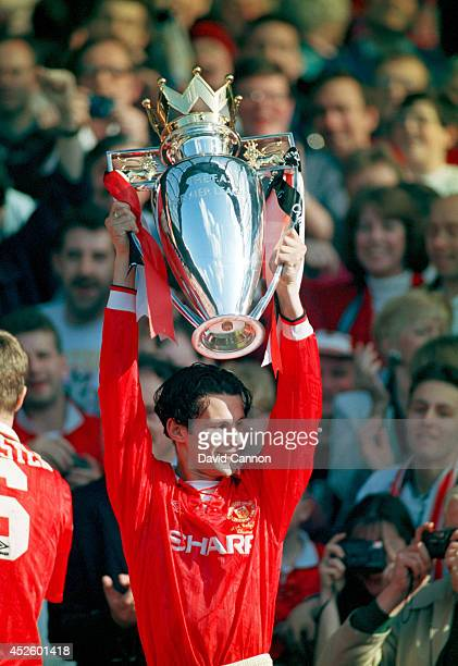 Manchester United forward Ryan Giggs lifts the Premier League trophy after the Premier League match between Manchester United and Coventry at Old...
