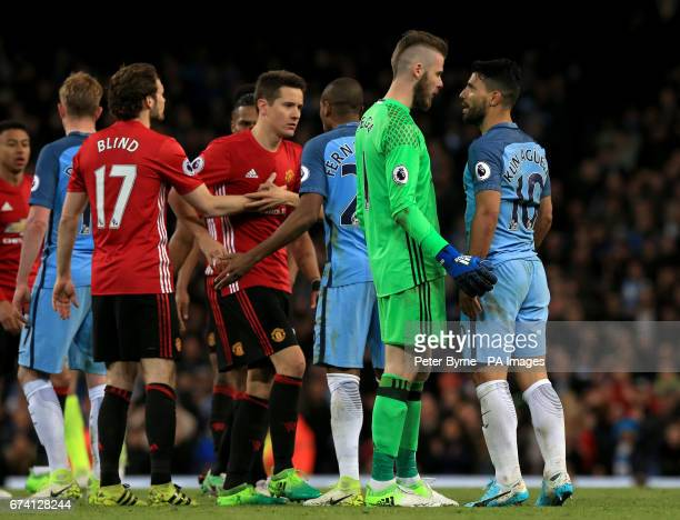 Manchester United goalkeeper David De Gea and Manchester City's Sergio Aguero speak during the Premier League match at the Etihad Stadium Manchester