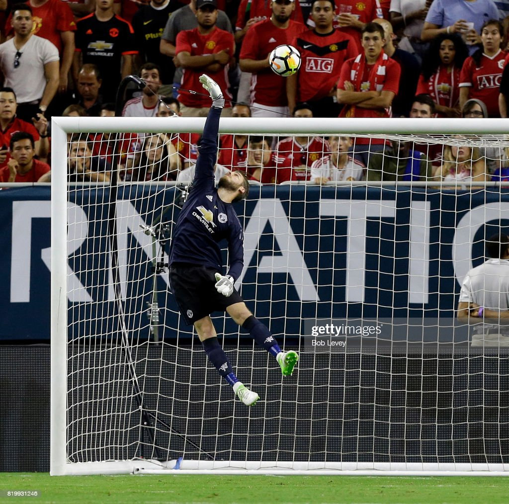 Manchester United goalkeeper David De Gea #1 makes a save against Manchester City in the first half at NRG Stadium on July 20, 2017 in Houston, Texas.