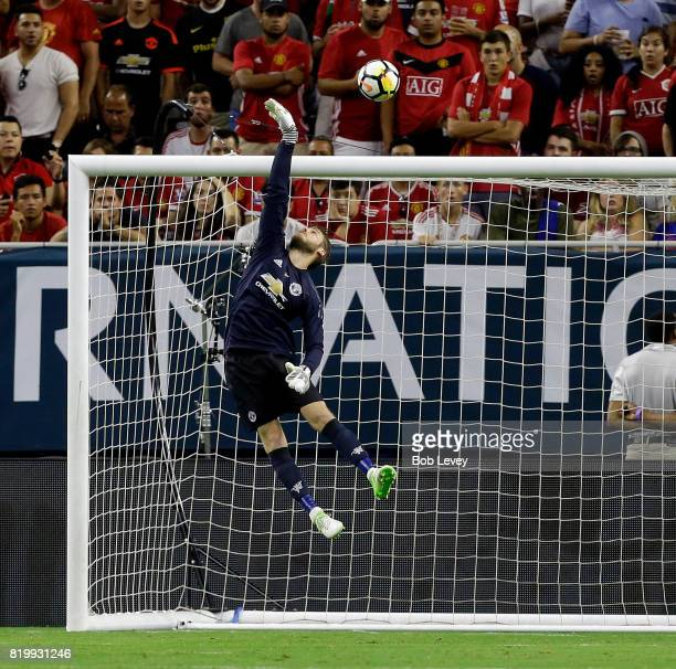 Manchester United goalkeeper David De Gea makes a save against Manchester City in the first half at NRG Stadium on July 20 2017 in Houston Texas