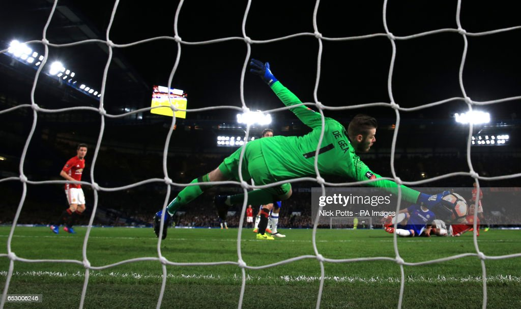 Manchester United goalkeeper David De Gea makes a save during the Emirates FA Cup, Quarter Final match at Stamford Bridge, London.