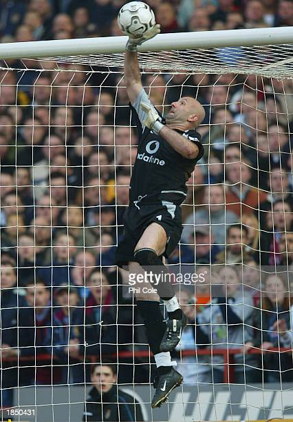 Manchester United goalkeeper Fabien Barthez makes a save during the FA Barclaycard Premiership match between Aston Villa and Manchester United at...