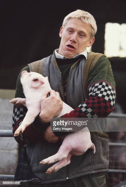 Manchester United goalkeeper Peter Schmeichel pictured with a pig during a Television commercial for Reebok in 1998
