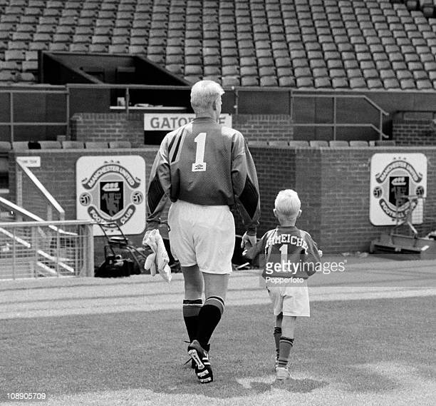 Manchester United goalkeeper Peter Schmeichel with his son Kasper at Old Trafford Manchester in August 1992