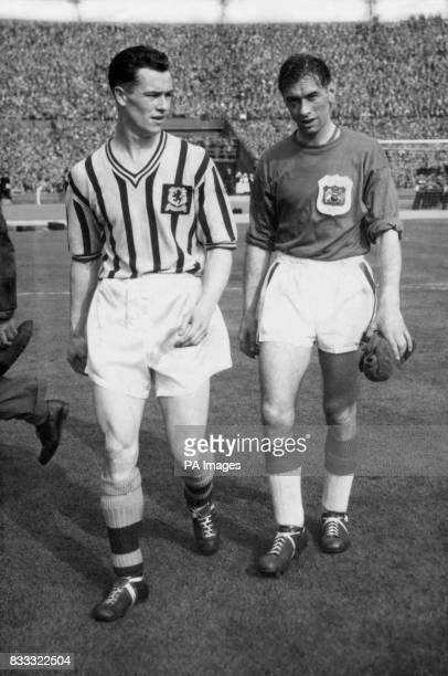 Manchester United goalkeeper Ray Wood and Aston Villa's Peter McParland leave the field together at the end of the Cup Final The match ended in a 21...