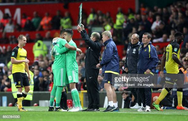 Manchester United goalkeeper Sergio Romero and Manchester United goalkeeper Joel Castro Pereira embrace during the Carabao Cup Third Round match at...