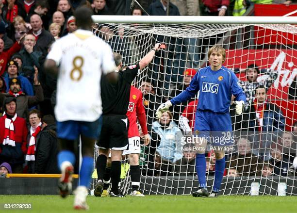 Manchester United goalkeeper Tomasz Kuszczak is dismissed by referee Martin Atkinson