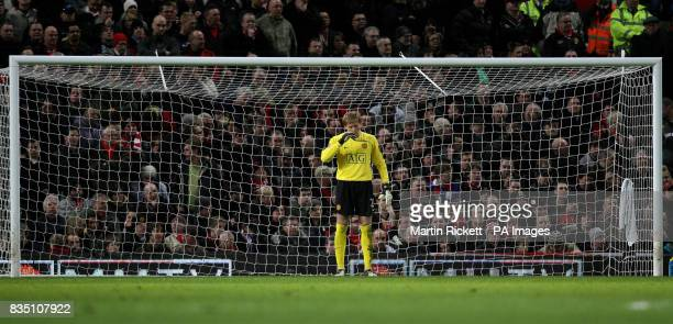 Manchester United goalkeeper Tomasz Kuszczak stands dejected after Blackburn Rovers' equalising goal during the Barclays Premier League match at Old...
