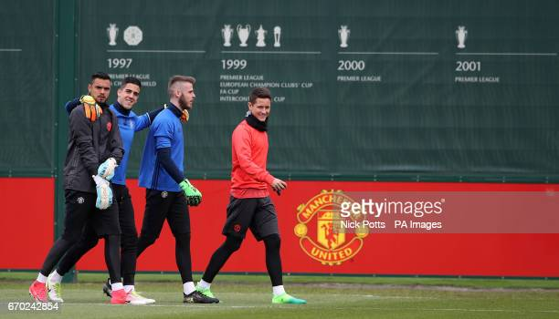 Manchester United goalkeepers David De Gea Sergio Romero Joel Castro Pereira and player Ander Herrera during the training session at the AON Training...