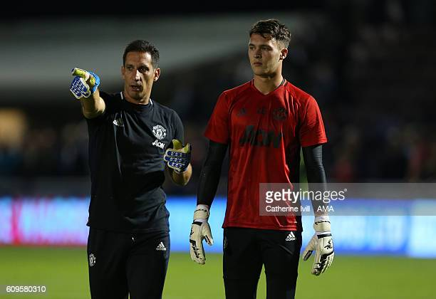 Manchester United goalkeeping coach Emilio Alvarez and Kieran O'Hara of Manchester United during the EFL Cup match between Northampton Town and...