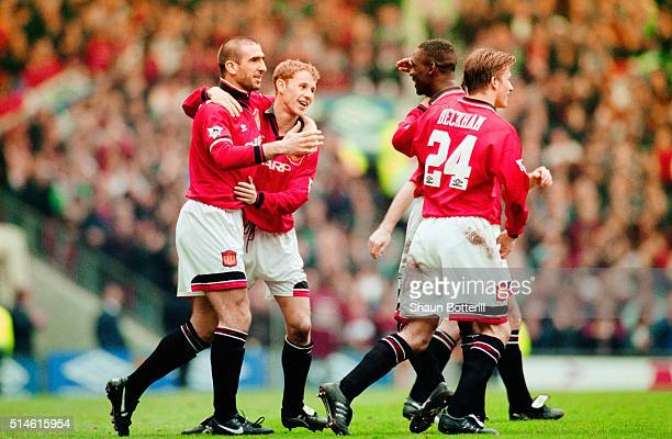Manchester United goalscorer Eric Cantona celebrates the winning goal with Nicky Butt Andy Cole and David Beckham during the FA Premier League match...