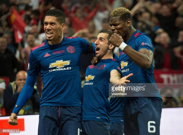 Manchester United goalscorer Henrikh Mkhitaryan celebrates with team mates Chris Smalling and Paul Pogba during the Europa League Final between...