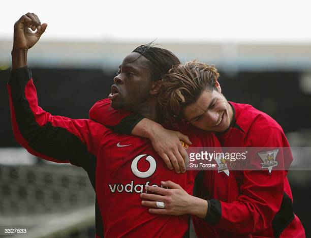 Manchester United goalscorers Louis Saha and Ronaldo celebrate after Saha had scored the secod goal for United during the FA Barclaycard Premiership...