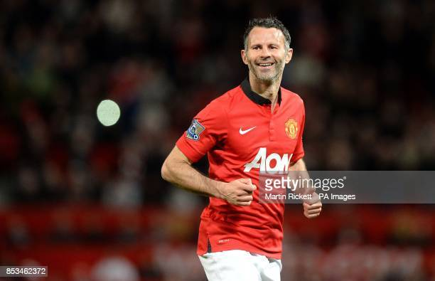 Manchester United interim manager Ryan Giggs smiles after his free kick was saved by Hull City's Eldin Jakupovic during the Barclays Premier League...