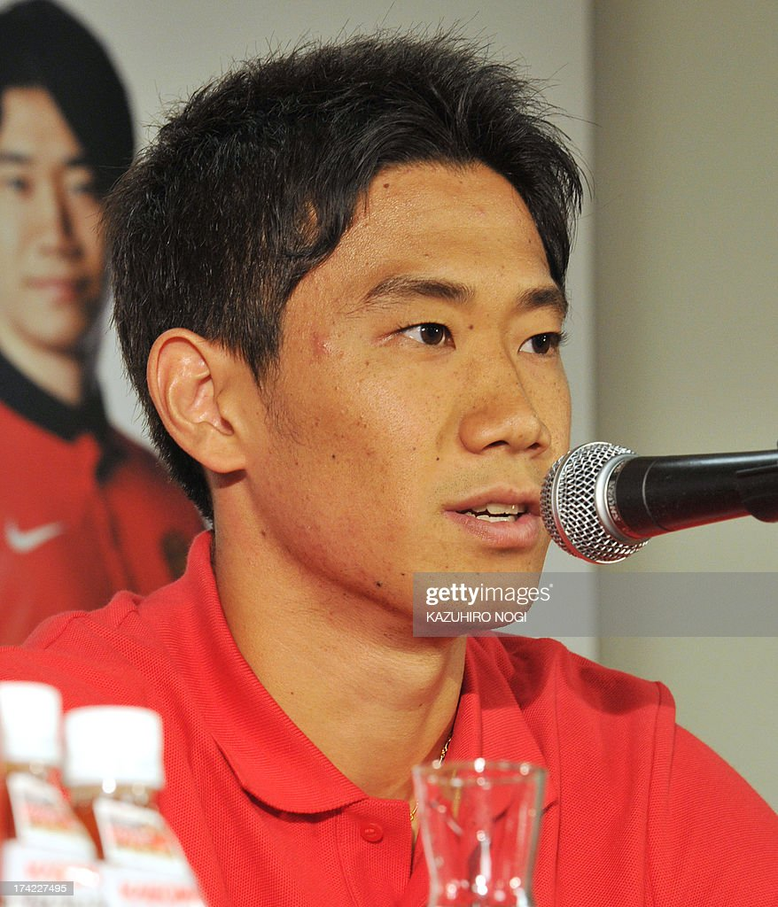 Manchester United Japanese player Shinji Kagawa speaks during a press conference prior to a training session at Nissan Stadium in Yokohama, suburban Tokyo on July 22, 2013. The United will play Yokohama F Marinos on July 23 and then face Kagawa's former J-League club Cerezo Osaka at Nagai Stadium on July 26.