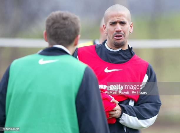 Manchester United Juan Veron shares a joke with Phil Neville in a training session at the Carrington training ground Manchester Thursday 27 February...